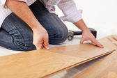 Laying laminate flooring - closeup — Stok fotoğraf