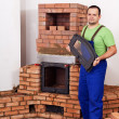 Stock Photo: Mason building fireplace