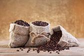 Coffee in burlap bags — Stock Photo