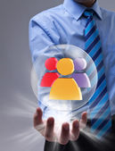 Social networking concept with glass sphere and colorful icon — Stock Photo