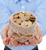 Man hands holding money bag with euro coins — Stock Photo