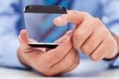Touchscreen gadget in businessman hands — Stock Photo