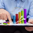 Businessman working on annual report - closeup on charts — Stock Photo