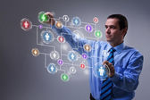 Businessman accessing modern social networking interface — Stock Photo