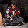 Poor beggar child boy reviews the money he received — Stock Photo