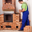 Mason building a masonry heater — Stock Photo