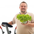 Overweight man with healthy choices - exercise and fresh food — Stock Photo