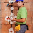 Electrician working inside new building — Stock Photo #30504227