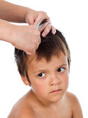 Little boy having a haircut at home — Stock Photo