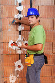 Electrician working inside new building — Stock Photo