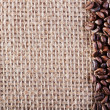 Coffee on burlap sack background — Photo
