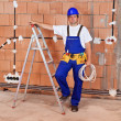 Electrician installing power cables in a new building — Stock Photo