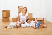 Happy people moving into a new house — Stock Photo