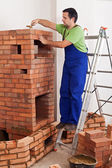 Worker building masonry heater — Stock Photo