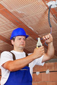 Electrician working with wiring in a new building — Stock Photo