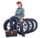 Boy sitting on car tires — Stock Photo