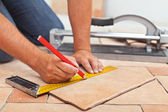 Laying ceramic floor tiles - man hands closeup — Stock Photo