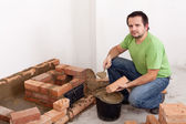 Building a brick stove — Stock Photo