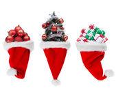 Christmas objects in santa hats — Stock Photo