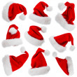 Santa Claus hats isolated on white — Stok fotoğraf