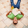 Worker resting on ceramic floor tiles — Stock Photo