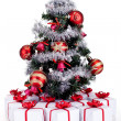 Small christmas tree with lots of presents — Stock Photo
