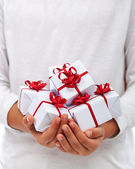 Christmas presents in child hands — Stock Photo