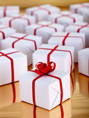 Christmas presents on golden surface — Stock Photo