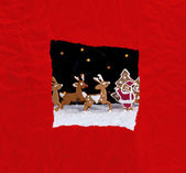 Christmas greeting card with red wrapping paper — Stock Photo