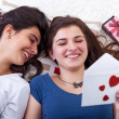 Stock Photo: Happy young girls reading love letter