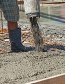 Pouring concrete at a construction site - closeup — Stock Photo