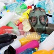 Child with gas mask covered with plastic bottles — Stock Photo #40773083