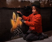Flames of hope - homeless boy warming — Stock Photo