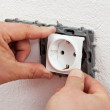 Installing electrical outlet or socket - closeup — Stock Photo