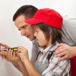 Father teaching son the basics of electrical work around the hou — Stock Photo #45811585