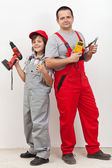 Boy helping his father with some electrical work — Stock Photo
