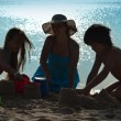Family playing on the beach - silhouettes — Stock Photo #45930117