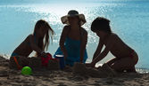Family playing on the beach - silhouettes — Stock Photo