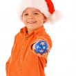 Boy with christmas bauble and santa hat - isolated — Stock Photo #6410435