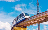 Cityscape with monorail train and TV tower — Stock Photo