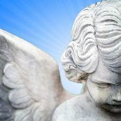 Angel on blue background — Stock Photo