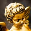 Little golden cherub — Stock Photo
