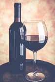 Wine glass bottle and barrel — Stock Photo