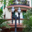 Stock Photo: Old home and lamp post
