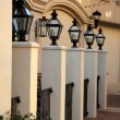 Lamp posts in a row — Stock Photo
