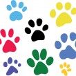 Set of vector colored paw prints — Stockvektor