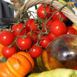 Tomatoes, oil and fresh vegetables — Stock Photo