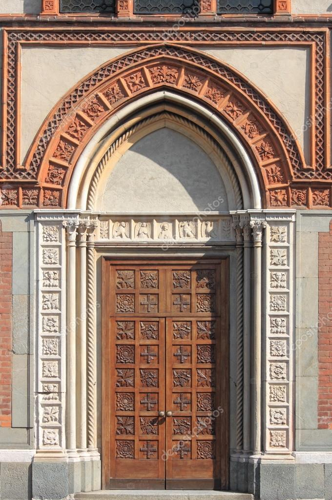 Entrance door of the romanic style church of Santa Maria in Strada. Monza, Italy  Stock Photo #13508730