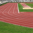 Racetrack and long jump pit — Stock Photo