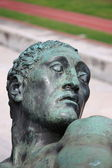Bronze head of a virile statue — Stock Photo